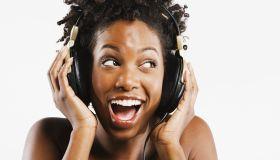 African American woman listening to headphones