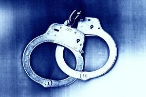 Blue tone of locked handcuffs.