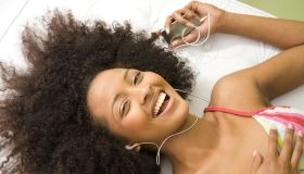 Laughing woman listening to mp3 player