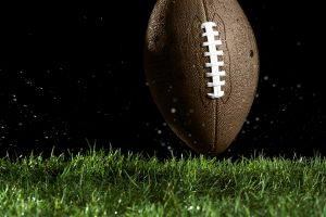 Football in motion over grass