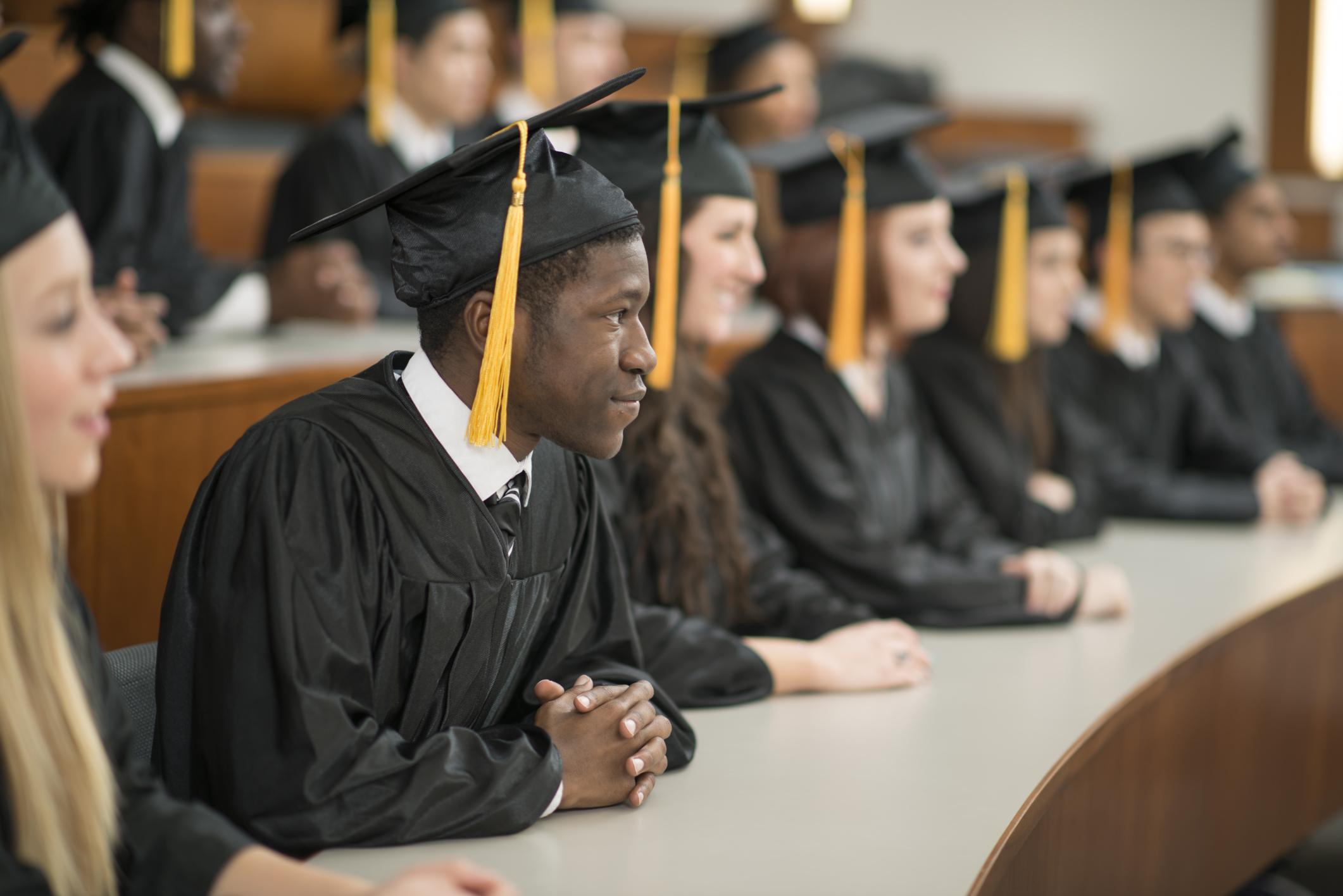 University Graduates Sitting in a Row