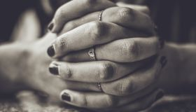 Close-Up Of Clasped Hands