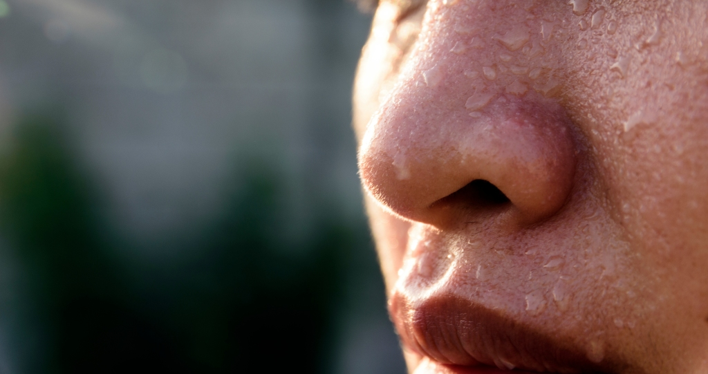 Close-Up Of Woman With Sweat On Face