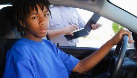 Teenage Boy Receiving a Ticket