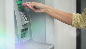 Woman using cash machine