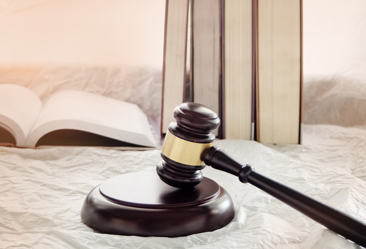 Close-Up Of Gavel On White Table