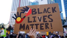 """Protesters display a huge placard reading """"Black Lives..."""