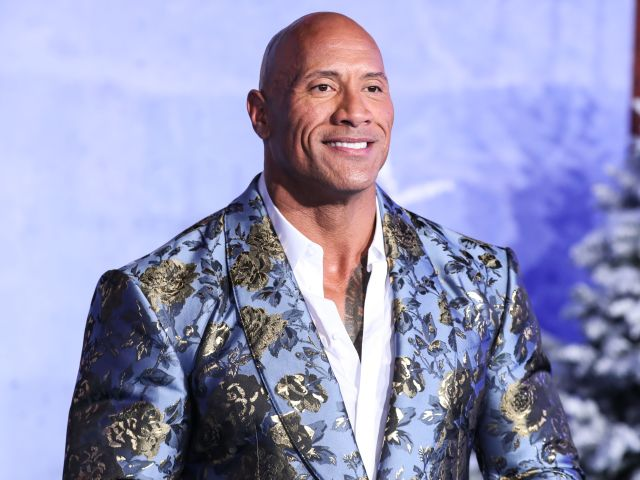 Actor Dwayne Johnson (The Rock) wearing Dolce & Gabbana arrives at the World Premiere Of Columbia Pictures' 'Jumanji: The Next Level' held at the TCL Chinese Theatre IMAX on December 9, 2019 in Hollywood, Los Angeles, California, United