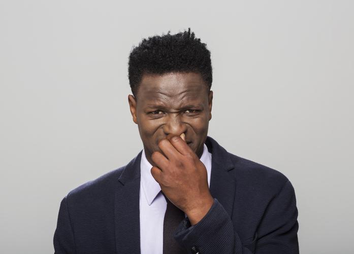 Portrait of man holding nose