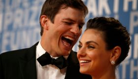 Actor Ashton Kutcher laughs with his wife actress Mila Kunis while posing for pictures on the red carpet for the 6th annual 2018 Breakthrough Prizes at Moffett Federal Airfield, Hangar One in Mountain View, Calif., on Sunday, Dec. 3, 2017. (Nhat V. Meyer/