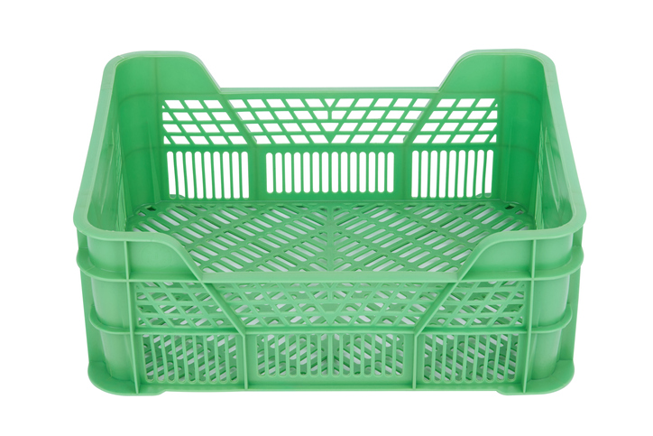 Green plastic crate isolated on white background