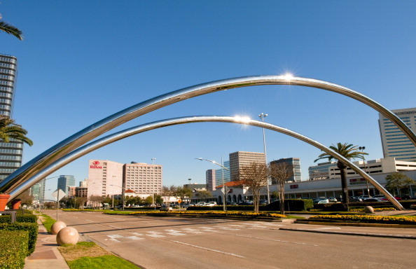 Skyline Of Houston Texas From Modern Chrome Curved Bars On Post Oak Blvd Showing New Building.