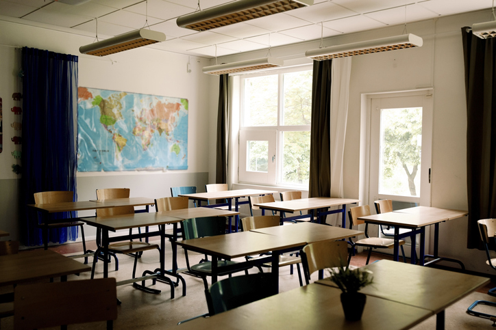 Desks and chairs arranged in classroom at high school